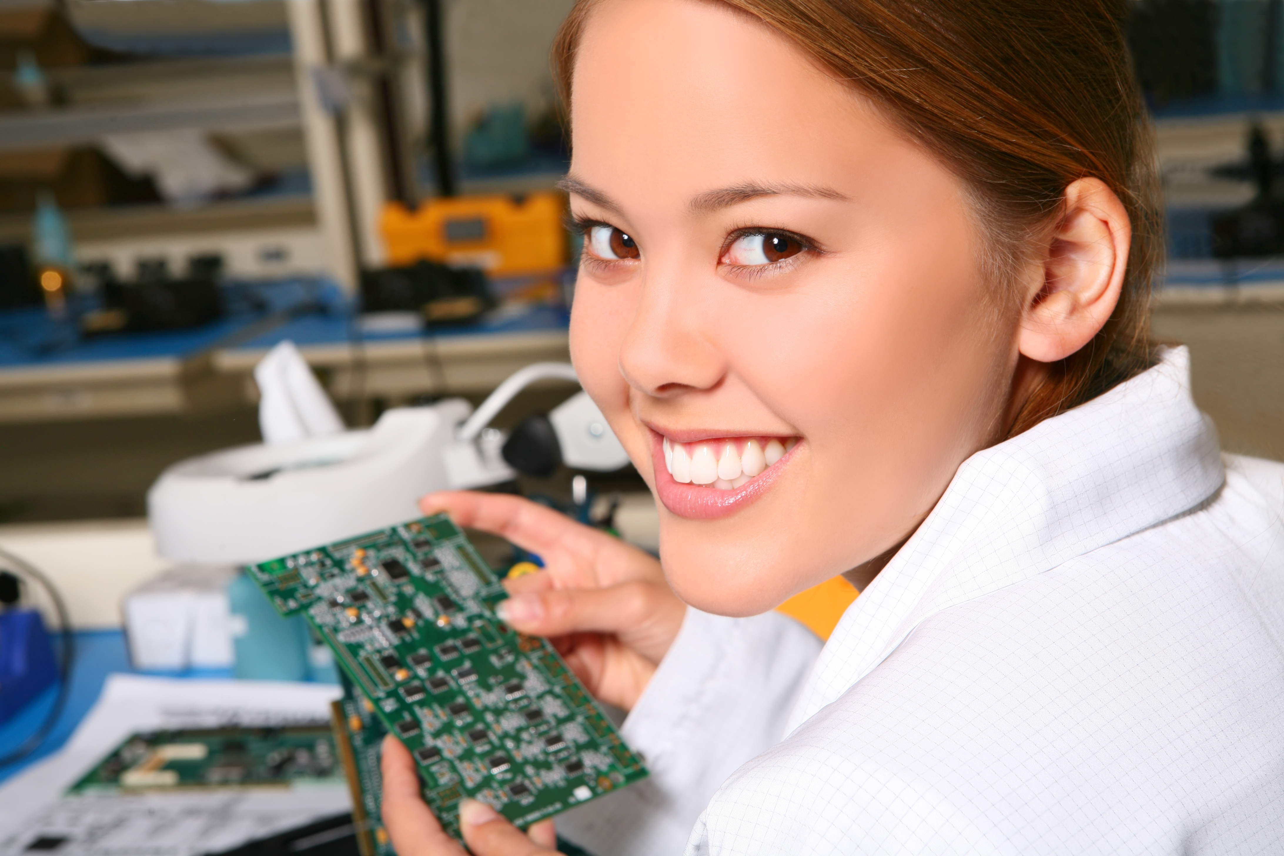 Woman and Circuit Board Curriculum Theory and Evidence